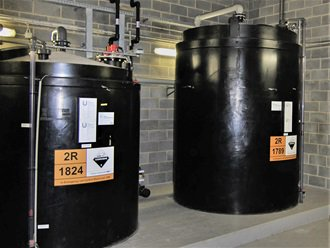 Chemical tanks for storing acids and alkalis.