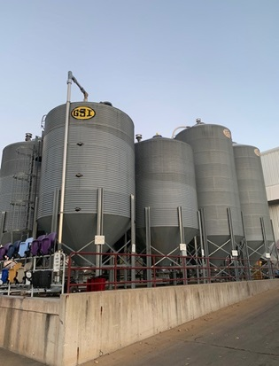 Multiple silos hold different varieties and grades of plastic pellets, all of which contribute to making different products.