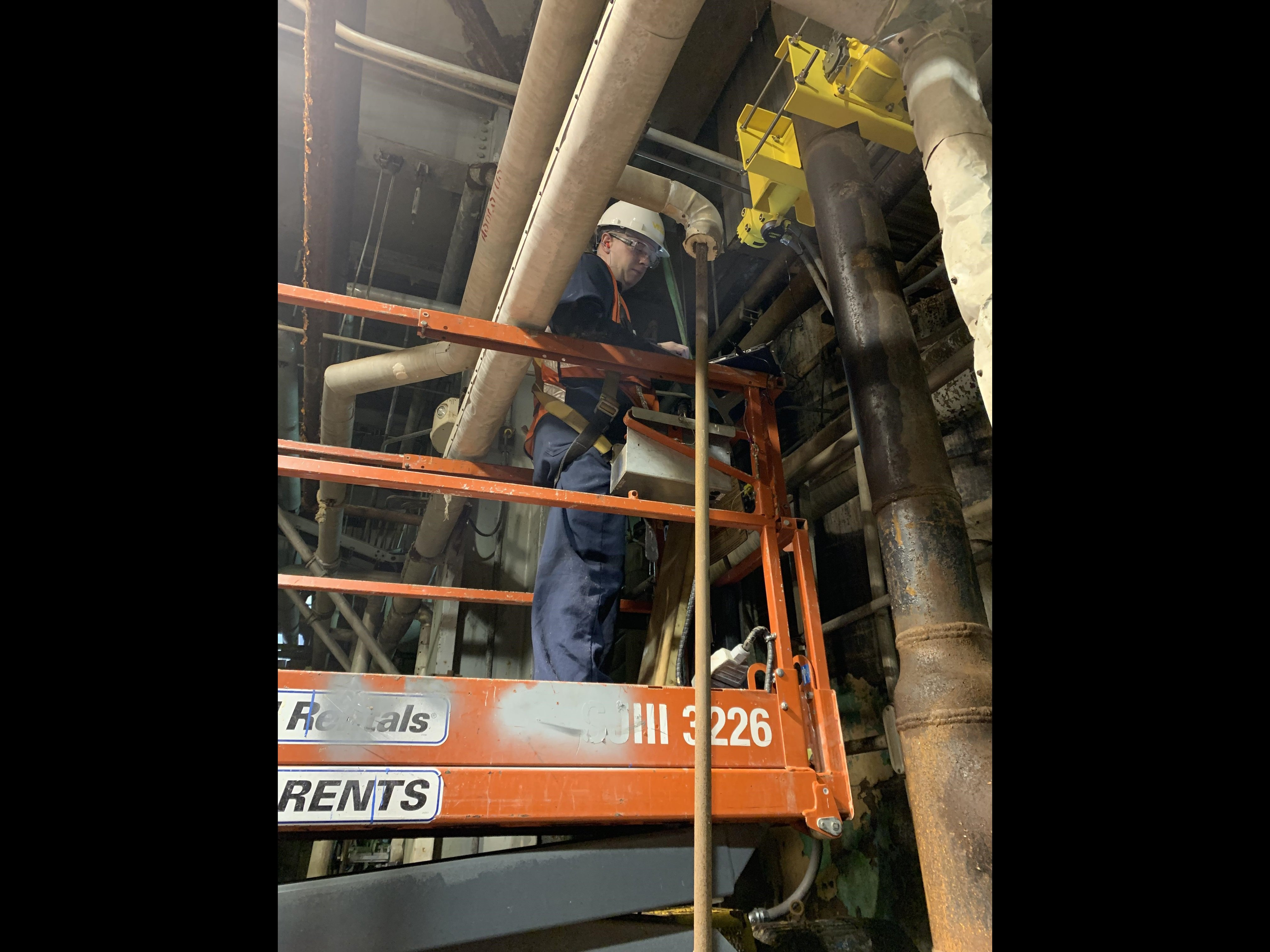 A VEGA Field Service Technician installs a MiniTrac 31 onto a pipe where the plant required a crucial density measurement.