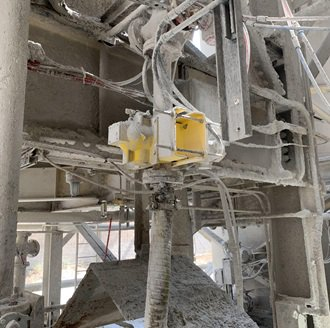 Radiometric density sensors continue to make accurate measurements despite dusty conditions at a cement plant.