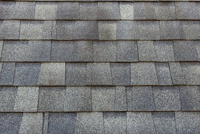 Asphalt roofing shingles installed on a house