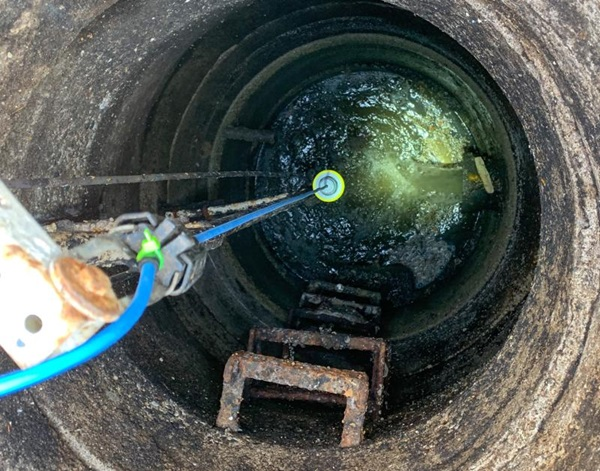 The VEGAPULS C 21 radar sensor in a wastewater lift station uses a blue cable to signify Intrinsically Safe Approvals